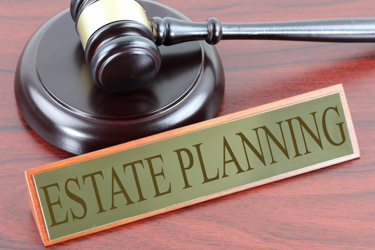 A judge's gavel next to a sign that says Estate Planning